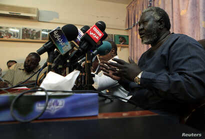 FILE - Malik Agar, of the Sudan People's Liberation Movement (SPLM), speaks during a joint news conference in Khartoum, July 3, 2011.