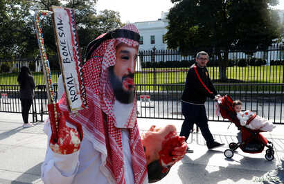 FILE - An activist dressed as Saudi Crown Prince Mohammad bin Salman marches in front the White House as another man pushes his child past in a stroller during a demonstration calling for sanctions against Saudi Arabia after the disappearance of Saud...
