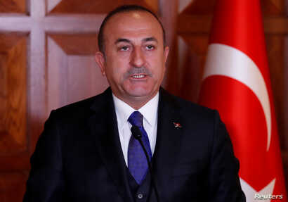 FILE - Turkish Foreign Minister Mevlut Cavusoglu attends a news conference in Ankara, Turkey, April 1, 2019.