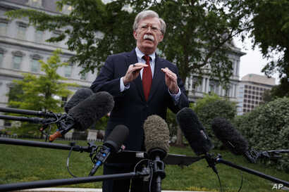 FILE - White House national security adviser John Bolton talks to reporters about Venezuela,  in Washington, May 1, 2019.