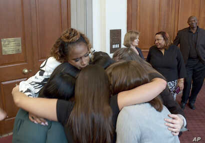 This image taken from video shows singer Jennifer Hudson embracing student journalists from Marjory Stoneman Douglas High School in Parkland, Fla., who were recognized at the 2019 Pulitzer Prize winners awards luncheon at Columbia University in New Y...