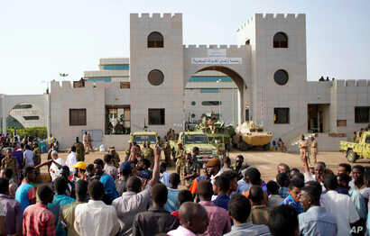 Sudanese demonstrators gather to protest against the army's announcement that President Omar al-Bashir would be replaced by a military-led transitional council, outside the Defense Ministry in Khartoum, Sudan, April 12, 2019.