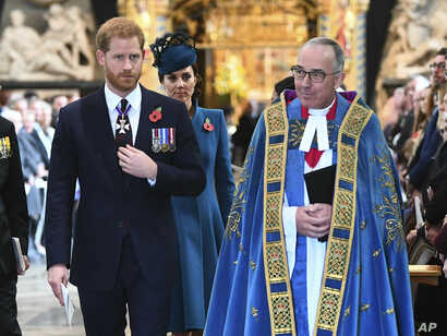 Catherine, The Duchess of Cambridge and Prince Harry at the ANZAC Dawn Service held at Westminster Abbey, London.