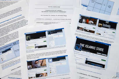 Pages from a confidential whistleblower's report obtained by The Associated Press are photographed in Washington, May 7, 2019.