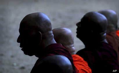 Buddhist monks pray during a ceremony to invoke blessings on the dead and wounded from Sunday's bombings at the Kelaniya temple in Colombo, Sri Lanka, April 24, 2019.
