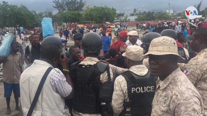 Protesters gather in front of of the Haitian parliament in Port au Prince, May 30, 2019.