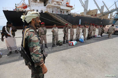 FILE - Yemen's Houthi movement forces are seen during withdrawal from Saleef port in Hodeidah province, Yemen, May 11, 2019.
