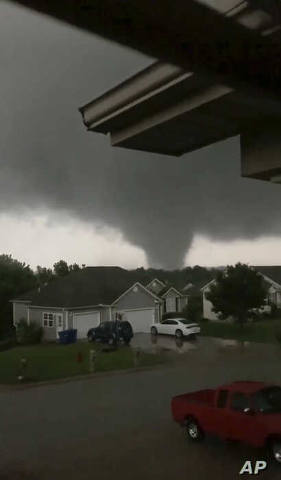 This still image taken from video provided by Chris Higgins shows a tornado, May 22, 2019, in Carl Junction, Mo. The tornado caused some damage in the town of Carl Junction, about 4 miles (6.44 kilometers) north of the Joplin airport.