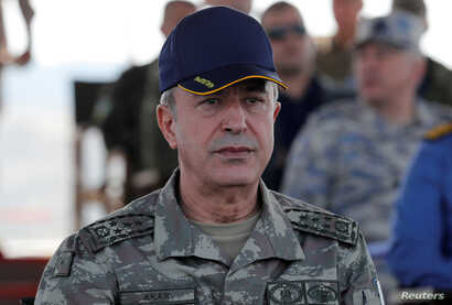 FILE - Turkey's Hulusi Akar, when he was chief of the general staff, during a military exercise near the Aegean port city of Izmir, Turkey, May 10, 2018.