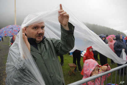 People wait for Pope Francis to celebrate Mass at the Marian shrine, in Sumuleu Ciuc, Romania, June 1, 2019.