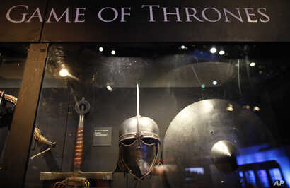 """FILE - In this is June 10, 2014 file photo of weapons from the """"Game of Thrones"""" are displayed at the Waterfront Hall, Belfast, Northern Ireland."""