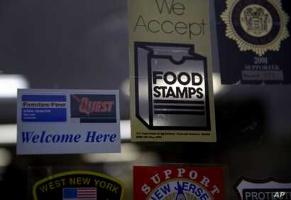 FILE - A supermarket displays stickers indicating it accepts food stamps in West New York, N.J., Jan. 12, 2015.