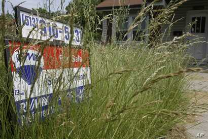 FILE -- Overgrown lawns are frowned upon in the United States and are thought to lower property values.