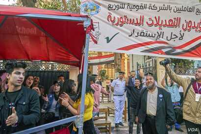 Some students said they were paid to stand at the polls for the day to boost the appearance of the turnout on April 20, 2019 in Cairo.