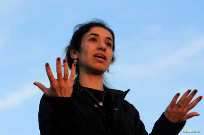 FILE - Nobel Peace Prize laureate, Yazidi activist Nadia Murad, gestures while talking to the people during her visit to Sinjar, Iraq, Dec. 14, 2018.