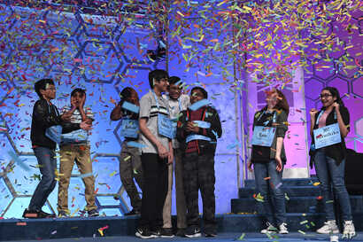 The eight co-champions of the 2019 Scripps National Spelling Bee celebrate their win in Oxon Hill, Md., Friday, May 31, 2019. (AP Photo/Susan Walsh)