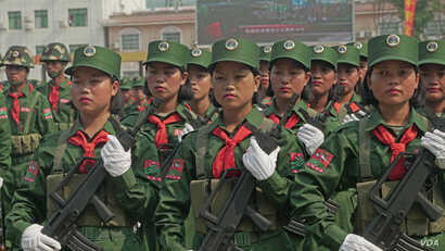 UWSA female soldiers stand at attention during the 30-year anniversary ceremony on April 17 in Panghsang, Special Region 2, Shan State. (Am Sandford/AsiaReports)