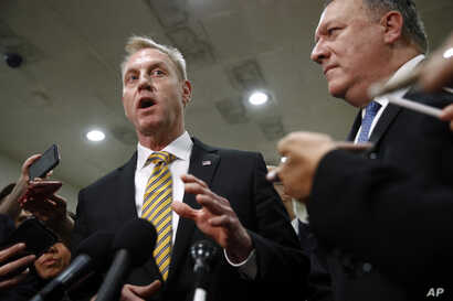 Acting Defense Secretary Patrick Shanahan, left, speaks to members of the media alongside Secretary of State Mike Pompeo after a classified briefing for members of Congress on Iran, on Capitol Hill in Washington, May 21, 2019.