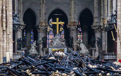 Debris are seen inside Notre Dame cathedral in Paris, April 16, 2019.