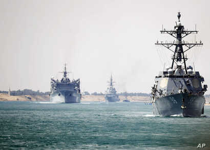In this photo provided by the U.S. Navy, the Abraham Lincoln Carrier Strike Group transits the Suez Canal, May 9, 2019.