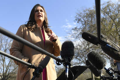 White House press secretary Sarah Sanders speaks to reporters outside the West Wing of the White House, March 25, 2019.