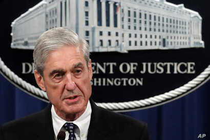 FILE - U.S. Special Counsel Robert Mueller talks to reporters about the Russia probe in this undated photo.
