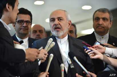 Iranian Foreign Minister Mohammad Javad Zarif, center, answers questions after a meeting with Japanese Foreign Minister Taro Kono at the foreign ministry in Tokyo, May 16, 2019.