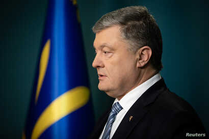 FILE - Ukraine's President Petro Poroshenko delivers a televised address after Russian authorities moved to simplify the process of obtaining Russian citizenship for Ukrainians living in areas controlled by Russia-backed separatists in eastern Ukrain...