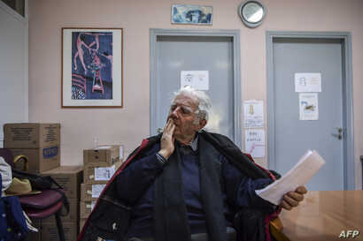 Retired tenor Achilleas Papadopoulos waits to receive his medicines at the social pharmacy of Elliniko, Greece, Feb. 27, 2019.