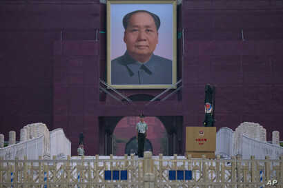 A Chinese paramilitary policeman stands guard in front of Mao Zedong's portrait on Tiananmen Gate on the 30th anniversary of a bloody crackdown of pro-democracy protesters in Beijing on Tuesday, June 4, 2019.