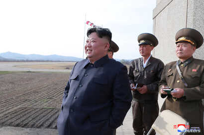 FILE - North Korean leader Kim Jong Un, accompanied by two military officials, observes a Korean People's Air Force training flight at undisclosed location in this April 16, 2019, photo released April 17, 2019 by North Korea's Central News Agency (KC...