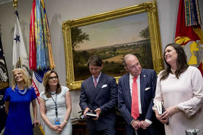 White House press secretary Sarah Sanders, right, accompanied by from left, counselor to the President Kellyanne Conway, Mercedes Schlapp, Director of strategic communications, Deputy press secretary Hogan Gidley, and chief economic adviser Larry Kud...