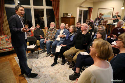 FILE - U.S. 2020 Democratic presidential candidate Andrew Yang speaks at Potluck Insurgency, a local Democratic activist event, at the home of one of its members in Iowa City, Iowa, March 10, 2019.