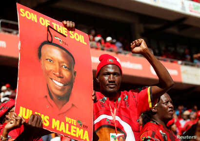 A supporter of Julius Malema's Economic Freedom Fighters (EFF) party holds a placard at the party's final election rally ahead of the country's May 8 poll, in Johannesburg, South Africa, May 5, 2019.