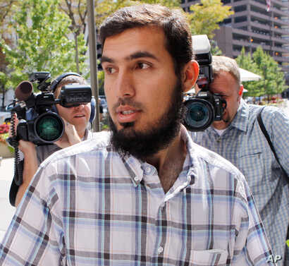 FILE - Najibullah Zazi arrives at the offices of the FBI in Denver for questioning, Sept. 17, 2009.