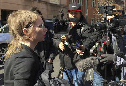 FILE - Chelsea Manning addresses the media outside federal court in Alexandria, Va., March 5, 2019. The former Army intelligence analyst was ordered to jail on March 8, 2019 for refusing to testify to a Virginia grand jury investigating Wikileaks.
