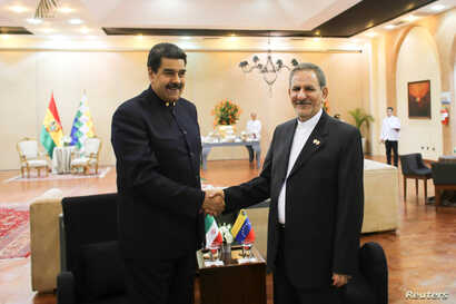 Venezuela's President Nicolas Maduro (L) shakes hands with Iran's Vice President Eshaq Jahangiri as they meet during the 4th Gas Exporting Countries Forum in Santa Cruz, Bolivia, Nov. 24, 2017.