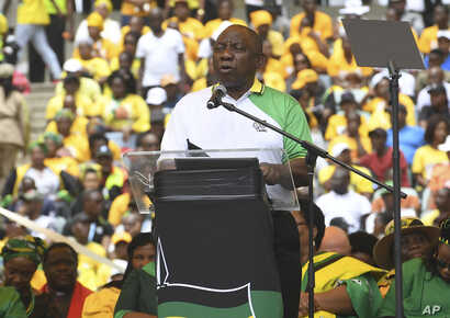 South African President Cyril Ramaphosa, delivers his party's election manifesto at the Moses Mabhida stadium in Durban, South Africa, Saturday, Jan 12, 2019 during the ruling party's 107th anniversary celebrations.