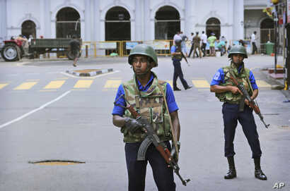 Sri Lankan Naval soldiers stand guard outside St. Anthony's Church in Colombo, Sri Lanka, April 29, 2019.