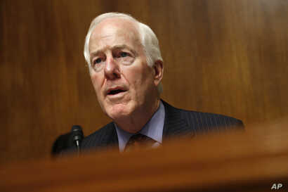 FILE - Senate Majority Whip Sen. John Cornyn, R-Texas, Chair of the Senate Judiciary Border Security and Immigration Subcommittee, speaks during a hearing about the border, May 8, 2019, on Capitol Hill in Washington.
