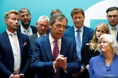 Leader of the Brexit Party Nigel Farage speaks as he and newly elected Members of the European Parliament from Brexit Party attend a news conference following the results of the European Parliament elections, in London, May 27, 2019.