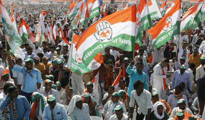 FILE - Supporters of India's main opposition Congress party attend a public meeting at Adalaj in Gandhinagar, India, March 12, 2019.