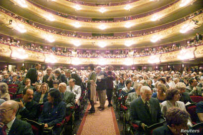 A full house prepares to listen to the Spanish opera star Montserrat Caballe during her first recital at Barcelona's refurbished Liceu theatre Oct. 15, 1994.