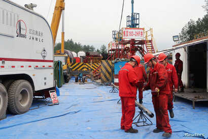 Employees work at a shale gas fracking site of Sinopec in Nanchuan, Chongqing, China March 18, 2018.