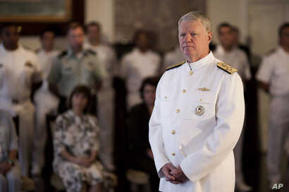 FILE - U.S. Chief of Naval Operations Admiral Gary Roughead attends a ceremony in Rio de Janeiro, Brazil, Wednesday Aug. 10, 2011.