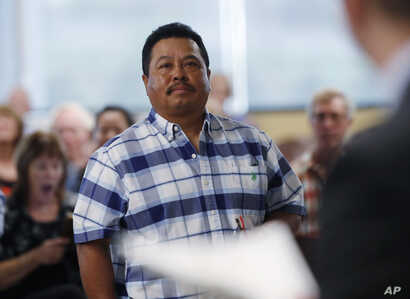 FILE - Fidel Tapia, of Mexico, waits to receive his citizenship in the United States at a naturalization ceremony, May 16, 2019, in Centennial, Colo.