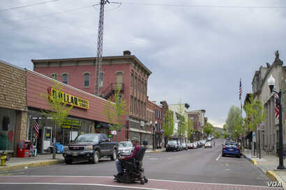 A resident of Danville, Pennsylvania crosses Mill Street, one of the town's main roads.