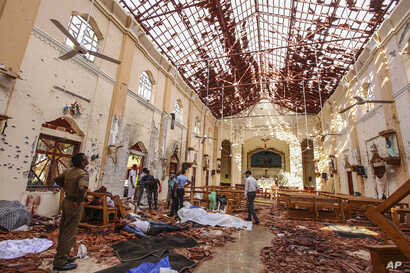 Dead bodies of victims lie inside St. Sebastian's Church damaged in blast in Negombo, north of Colombo, Sri Lanka, April 21, 2019.