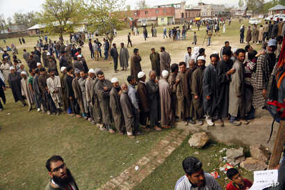Kashmiri voters stand in a queue to cast their votes outside a polling station at Shadipora, outskirts of Srinagar, Indian controlled Kashmir, April 11, 2019.