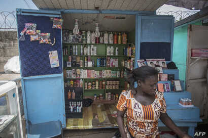 FILE - A shop sells skin-lightening products in Accra, Ghana, on July 3, 2018.